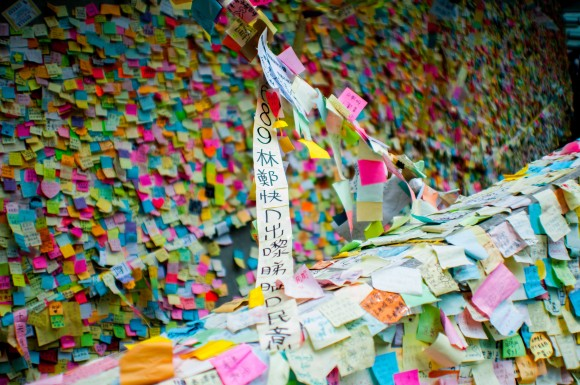 Post-it notes on the Lennon Wall.