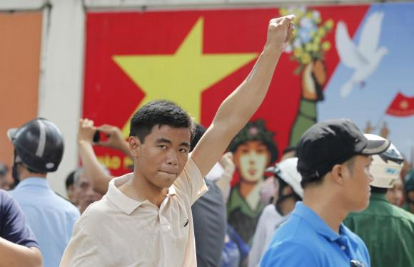 A protester gestures as he marches during an anti-China protest in Vietnam's southern Ho Chi Minh city