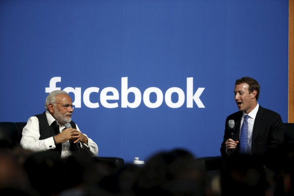 Indian Prime Minister Narendra Modi and Facebook CEO Mark Zuckerberg speak on stage during a town hall at Facebook's headquarters in Menlo Park, California