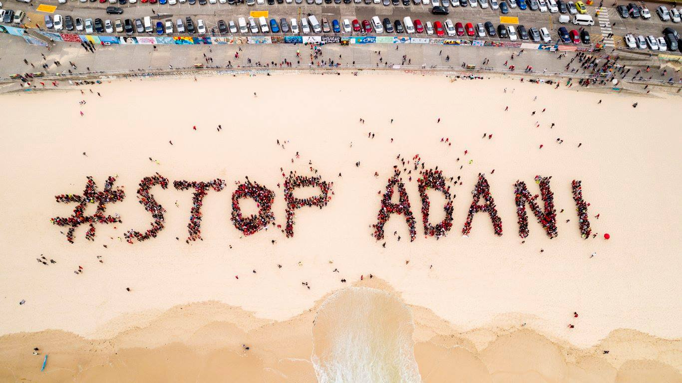 Over 2,000 people came together on Bondi Beach in Sydney to spell it out: #StopAdani . Photo: Stop Adani Campaign